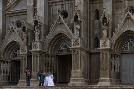 San Isidro, Costa Rica - May 21 : Bride walking into the Church of Coronado on her wedding day. May 21 2016, San Isidro Costa Rica.
