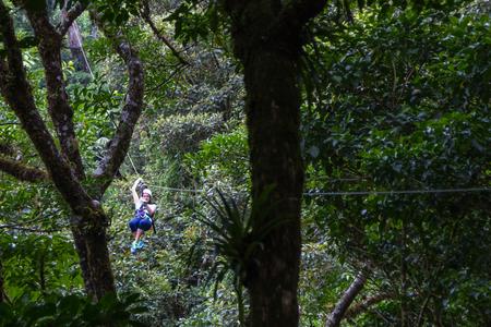 adventurous: Monteverde, Costa Rica - May 29 : young adventurous woman zip lining thru the cloud forest. May 29 2016, Monteverde, Costa Rica.
