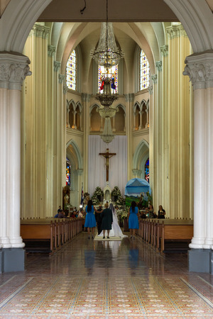 san isidro: San Isidro, Costa Rica - May 21 : Bride walking into the Church of Coronado on her wedding day. May 21 2016, San Isidro Costa Rica.