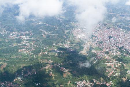 thru: Alajuela, Costa Rica - May 24 : The landscape of Costa Rica thru the clouds form a local flight, Costa Rica. May 24 2016, Alajuela Costa Rica.