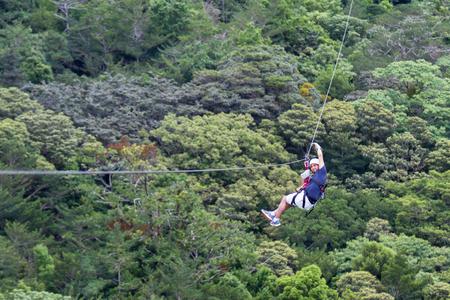 adventurous: Monteverde, Costa Rica - May 29 : young adventurous man zip lining thru the cloud forest. May 29 2016, Monteverde, Costa Rica. Editorial