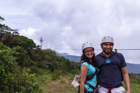 adventurous: Monteverde, Costa Rica - May 29 : young adventurous couple smiling after a zip line adventure. May 29 2016, Monteverde, Costa Rica. Editorial