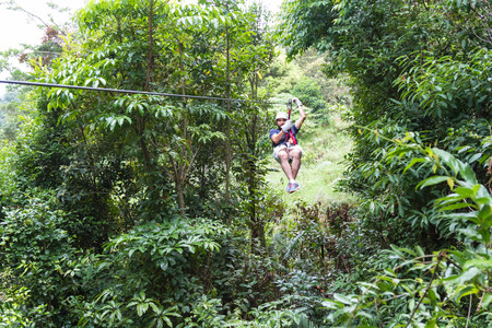 Monteverde, Costa Rica - May 29 : young adventurous man zip lining thru the cloud forest. May 29 2016, Monteverde, Costa Rica. 에디토리얼