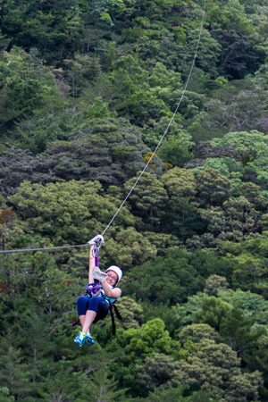 Monteverde, Costa Rica - May 29 : young adventurous woman zip lining thru the cloud forest. May 29 2016, Monteverde, Costa Rica.