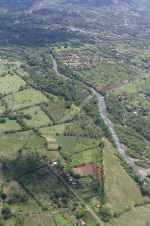 thru: Alajuela, Costa Rica: The landscape of Costa Rica thru the clouds form a local flight, Costa Rica. .