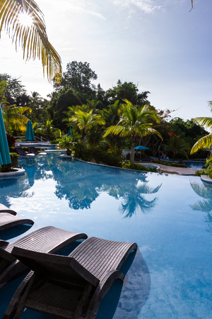 relaxing swimming pool surrounded by natural tropical greenery in the pacific coast of Panama