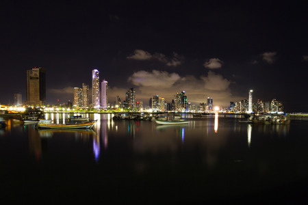 Panama City, Panama- June 08: Twilight Cityscape from across the bay in Panama with a serene reflection on the water. June 08 2016, Panama City, Panama.