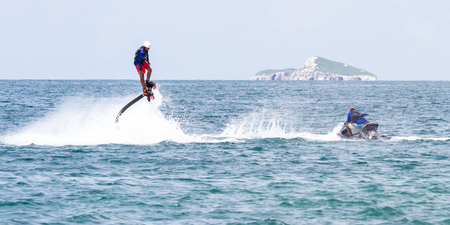 thrilling: Santa Clara, Panama- June 12: Local people enjoying a thrilling experience on a flyboard in the Pacific ocean. June 12 2016, Santa Clara, Panama.