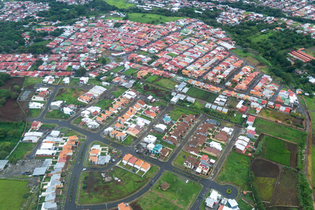 Alajuela , Costa Rica- June 20: Housing and infrastructure viewed form above in the central valley. June 20 2016, Alajuela, Costa Rica.