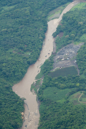 dense green vegetation with a rushing river seen from above during a local flight across Costa Rica