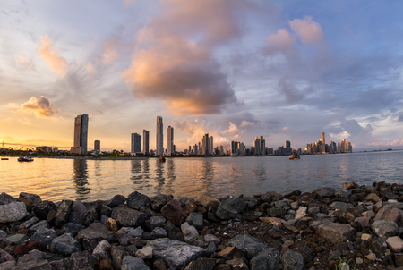 Panama City, Panama- June 08: Cityscape from across the bay with colorful sunset colors on the clouds. June 08 2016, Panama City, Panama.