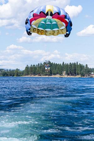 Coeur d Alene, Idaho - August 12: Exiting summer parasailing adventure in lake Coeur d Alene. August 12 2016, Coeur d Alene, Idaho.
