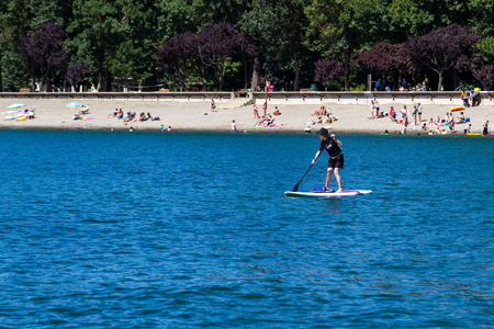 alene: Coeur d Alene, Idaho - August 12: busy beach with families enjoying the lake and beautiful summer weather. August 12 2016, Coeur d Alene, Idaho.