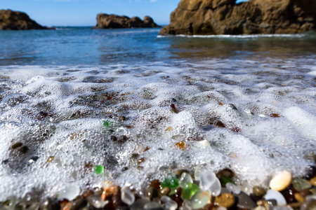 dumps: colorful glass pebbles blanket this beach in Fort Bragg, the beach was used as a garbage dump years ago, nature has tumbled the glass and polished it making it a tourist destination