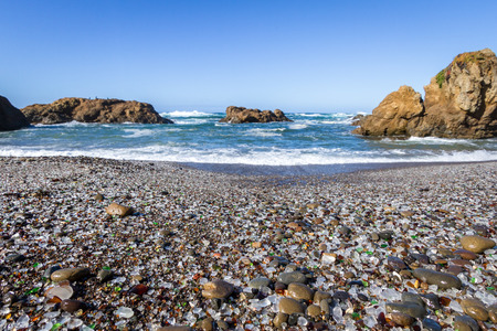 dumpster: Beautiful sea glass in a variety of colors with blue waves and sky in Fort Bragg, California