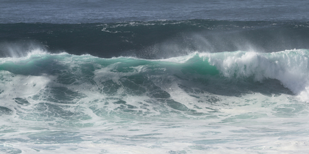 beautiful close up of a colorful wave folding in on itself
