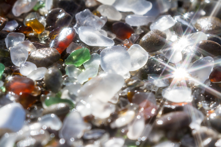 close up of the glass pebbles that cover this beach in Fort Bragg using a on camera star filter for a soft dreamy effect