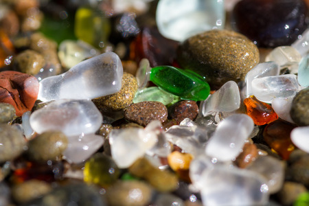 macro of a colorful group of sea glass pieces under bright sunshine Stock Photo