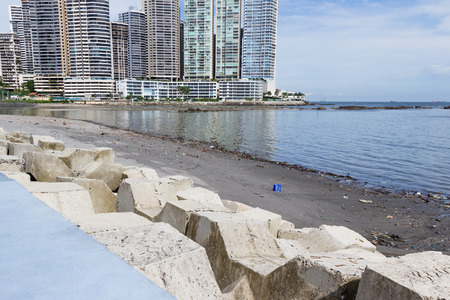 Panama City, Panama- June 08: view of a beach with garbage and plastic with beautiful buildings in the background. June 08 2016, Panama City, Panama.