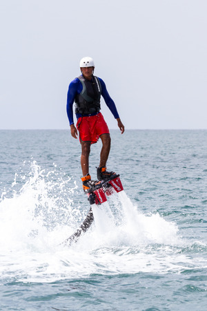 Santa Clara, Panama- June 12: Local people enjoying a thrilling experience on a flyboard in the Pacific ocean. June 12 2016, Santa Clara, Panama.