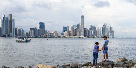 small world: Panama City, Panama- June 08: young children enjoying a beautiful view go the City. June 08 2016, Panama City, Panama.