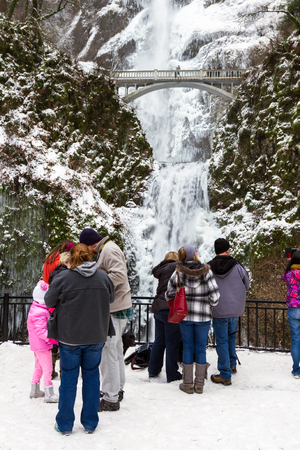 west end: Multnomah, Oregon - December 17: Polar vortex at the end of 2016 bringing extreme low temperatures and tourists to view Multnomah Falls in rare icy conditions. December 17 2016 Multnomah, Oregon.