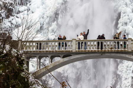 Multnomah, Oregon - December 17: Polar vortex at the end of 2016 bringing extreme low temperatures and tourists to view Multnomah Falls in rare icy conditions. December 17 2016 Multnomah, Oregon.