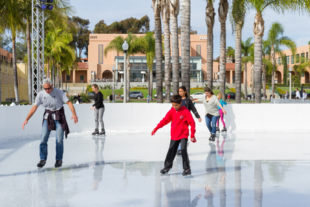 San Diego, California - November 26: People enjoying a beautiful winter day by ice skating in southern California. November 26 2016, San Diego, California. Editorial