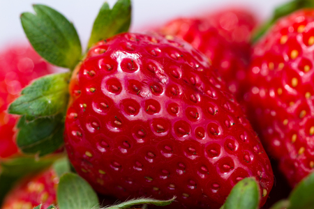 close up of a bunch or organic strawberries with a vibrant red color Stock Photo