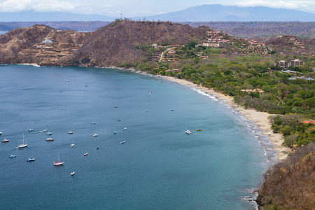 beautiful view of Hermosa Bay in Guanacaste Costa Rica, with deep blue water and white sand