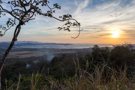 beautiful sunset in Salinas Bay, Guanacaste, Costa Rica with a bit of smoke in the air from prescribed burns in the surrounding areas. Stock Photo