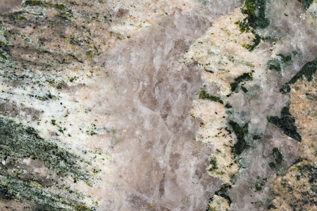 close up of  green granite countertop with a vein of quartz crystal thru the middle of it Stock Photo - 81204911