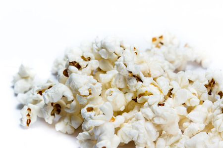 close up of a bunch of popcorn on a white background