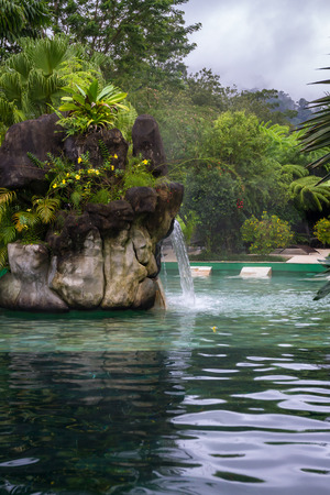 relaxing hot mineral pools in La Fortuna Costa Rica with green tropical vegetation