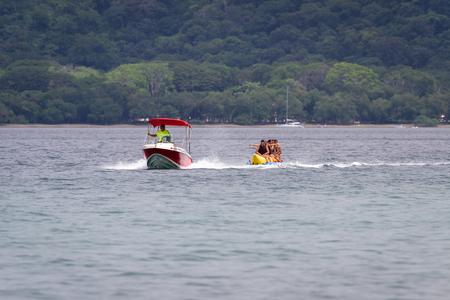 Guanacaste, Costa Rica- July 25: Family enjoying a banana boat ride  in Nacascolo Beach. July 25 2017, Guanacaste, Costa Rica.