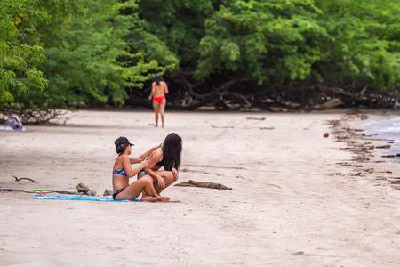 Guanacaste, Costa Rica- July 25: Beautiful young women enjoying the sun in Nacascolo Beach. July 25 2017, Guanacaste, Costa Rica.