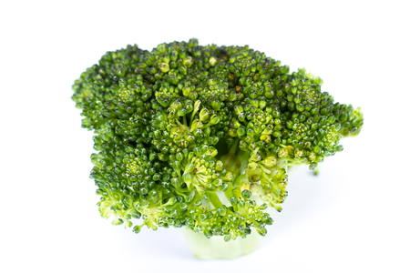 fresh organic broccoli isolated over a white background
