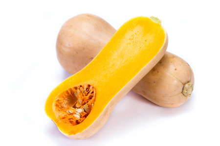 organic butternut squash cut in half isolated on a white background