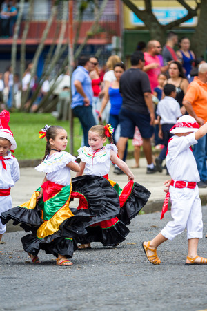 typical: Young children celebrating independence day in Costa Rica with traditional clothing and dancing. Editorial