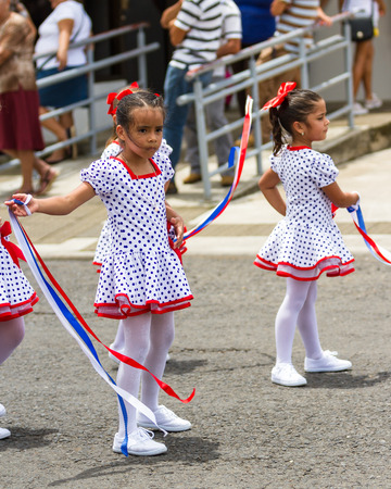 typical: School children marching in the town square celebrating Independence Day. Editorial
