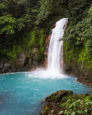 north cascade national park: Beautiful waterfall in northern Costa Rica inside the Tenorio National Park with a bright turquoise color in the water Stock Photo