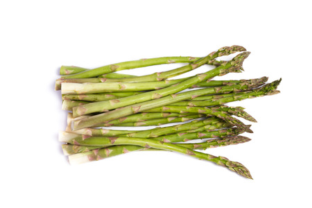 close up of a group of asparagus spears isolated on a white background