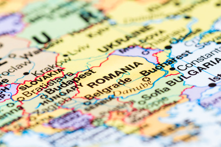 close up of a world map with the country of Romania in focus 스톡 콘텐츠