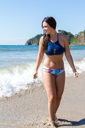 Beautiful Costa Rican model posing in a bathing suit with Flamingo beach in the background