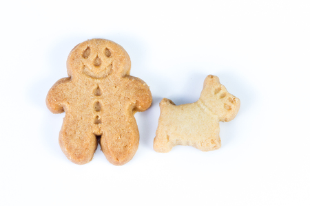 group of gingerbread man standing together with their scotty dog on a white background