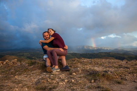 Young couple enjoying the spectacular views of Guanacaste Costa Rica from the top of this local treasure, Cerro Pelado at sunset