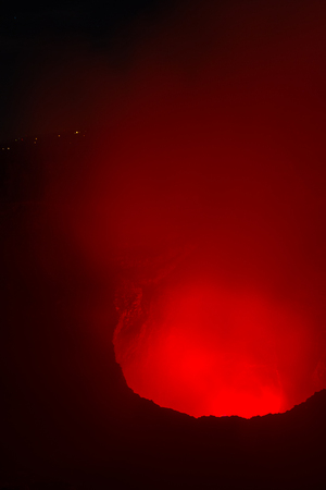 night time shot of the glowing red steam being let out into the air from this Volcano near Managua, Nicaragua