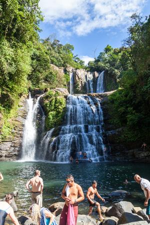 Nauyaca, Costa Rica - January 28: People enjoying a dip and the view of these waterfalls. January 28 2018, Nauyaca, Costa Rica Editorial