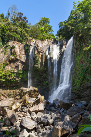 beautiful waterfalls in the south pacific of Costa Rica, Nauyaca falls surrounded by dense vegetation. Stock Photo