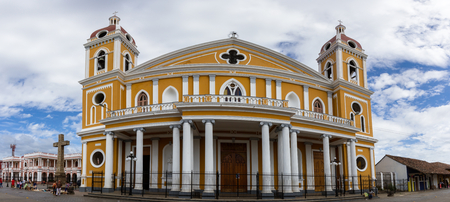 Granada, Nicaragua - January 20: Man trapped in a large window of the cathedral. January 20 2018, Granada, Nicaragua